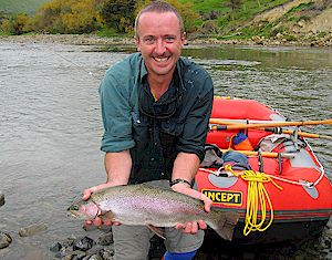 Paul on a rafting trip - nice rainbow